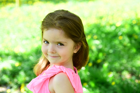 Summer girl fashion. Happy childhood. Little girl in sunny spring. Springtime. weather forecast. face and skincare. allergy to flowers. Small child. Natural beauty. Childrens day. Green plant.