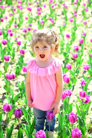 Spring everywhere. face and skincare. allergy to flowers. Small child. Natural beauty. Childrens day. Little girl in sunny spring. Summer girl fashion. Happy childhood. Springtime tulips.