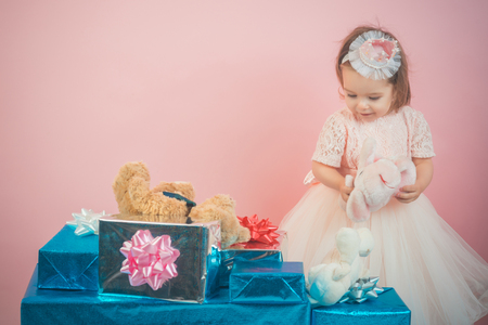 happy childhood of little girl. Kid shopping. Christmas gift. Thanks for your purchase. small girl child with present box.