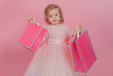 happy childhood of little girl. Kid shopping. shopping bags. Christmas gift. 写真素材