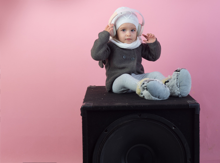 little girl child smiling. small happy girl. Hip and stylish. Funky beauty. kid listen music with headset and mp3 on phone.