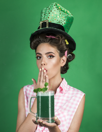 pin up woman with trendy makeup. pinup girl with fashion hair. retro woman drink summer cocktail. St. Patricks Day pretty girl in vintage style. Playful girl. Stock Photo