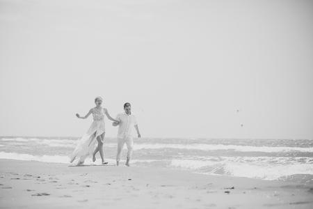 Young wedding couple on beach