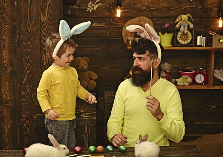 Easter family with fake bunny ears. Stock fotó