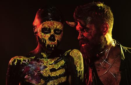 Halloween couple of woman girl skull skeleton and satan man