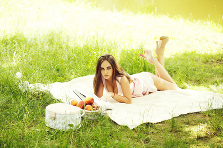 pretty woman on grass with fruit basket