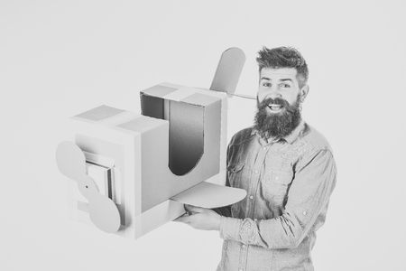 Bearded man father hold cardboard plane isolated on white.