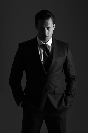 man with serious face and stylish hair in suit