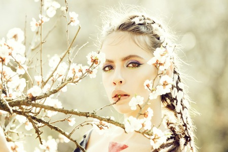 woman in white cherry or apricot spring flower blooming