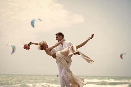 Pretty wedding pair on beach Stock Photo
