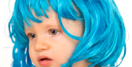 Beauty look hairstyle for cosplay party. Small child wear blue wig hair. Small kid in fancy wig hairstyle. Adorable little child in fashion wig. Cute baby with long blue hair. I love changing my hair.