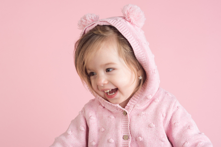 having fun. little girl child smiling. autumn and spring kid fashion. small happy girl. childhood and happiness. Hurray. Pure joy. pink background.