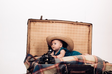 Good mood. Sweet little baby. New life and birth. Childhood happiness. Photo journalist. Small girl in suitcase. Traveling and adventure. Family. Child care. Portrait of happy little child.