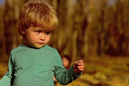 Boy play in park. Adorable little boy on sunny outdoor. I will grow fast Imagens
