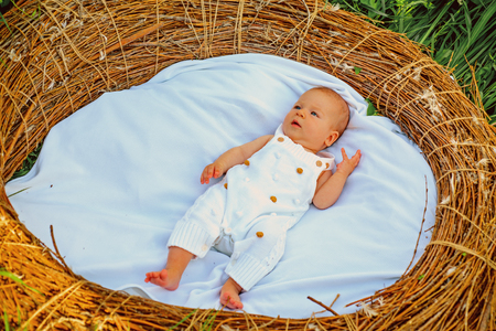 Little baby bathing. Newborn baby in wicker crib. Little boy or girl relax outdoor. Child care and treatment. Health care. Bathing beauty Standard-Bild - 115010792