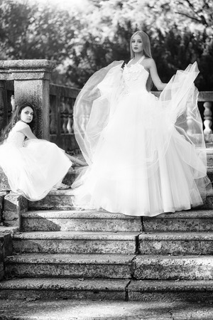 Beautiful bride with girl on stairs