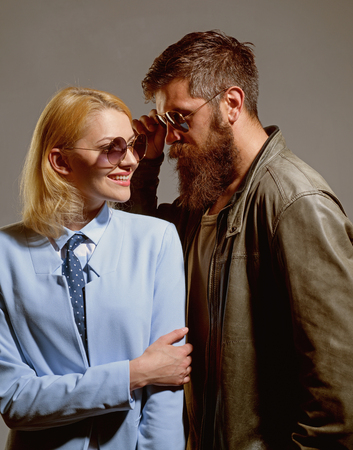 Enjoying every minute together. Couple of man and woman wear fashion glasses. Couple in love. Fashion models in trendy sun glasses. Love relations. Friendship day. Friendship relations. Love story. Archivio Fotografico - 120320498