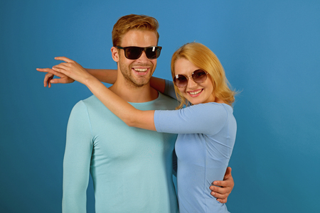 I love you. Couple in love. Couple of man and woman wear fashion glasses. Fashion models in trendy sun glasses. Love relations. Friendship day. Friendship relations. We got this gift of love. Banco de Imagens