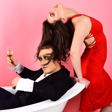 Love language without words. Couple of mime man and sensual woman. Mime artists. Couple in love mime enjoy in bath room. A mime show. Telling a love story through body motions. A silent art.