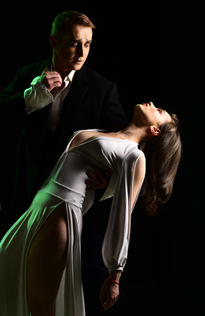 Theater actors miming through body motions. Mime man and woman act in romantic scene. Couple of mime artists perform romance on stage.