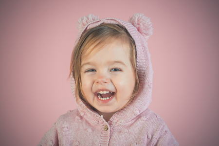 having fun. autumn and spring kid fashion. small happy girl. little girl child smiling. childhood and happiness. Little cutie. happy childrens day. smile. Stock Photo