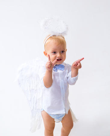 Pure and innocent. Christmas party celebration. Baby angel. Adorable little angel boy. Little boy with angel wings and halo. Cute valentines cupid or cherub baby. Christmas angel. Archivio Fotografico - 115011001