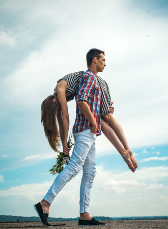 Eternal love. man and woman on their way. Problems in relations. man carries a girl on sky. outdoor walking. tired after exhausting day. hiking travel. couple in love. young couple outdoor.