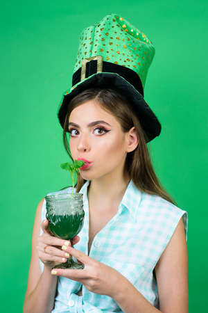 St. Patricks Day pinup girl with fashion hair. pretty girl in vintage style. pin up woman with trendy makeup. retro woman drink summer cocktail. Going crazy. Stock Photo