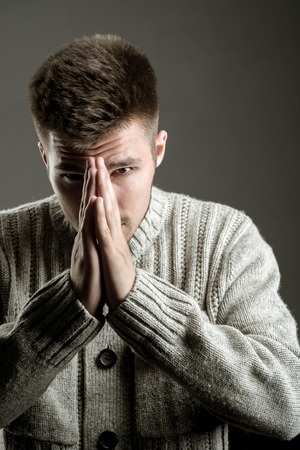 pray. fashion man with unshaven beard. Fashion portrait of man. facial emotions. male grooming and barber. man. Beard and facial care. wishing and hoping. loneliness.