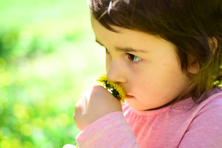 Little girl in sunny spring. face skincare. allergy to flowers. Summer girl fashion. Happy childhood. Small child. Natural beauty. Childrens day.