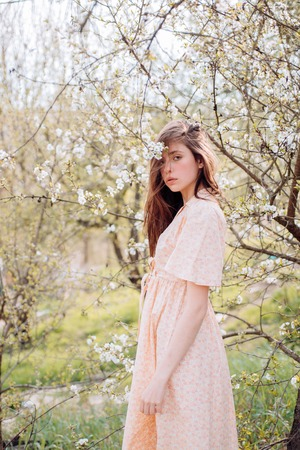 Spring woman. Springtime and vacation. blossom. Enjoying spring day. Woman with fashion makeup. Natural beauty and spa therapy. Summer girl with long hair. face and skincare. Travel in summer.