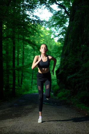 Run to success. Sport and sportswear fashion. Sport success. Fitness woman with good athlete body. fit your body and lose weight. Healthy lifestyle concept. sporty woman training in green forest.