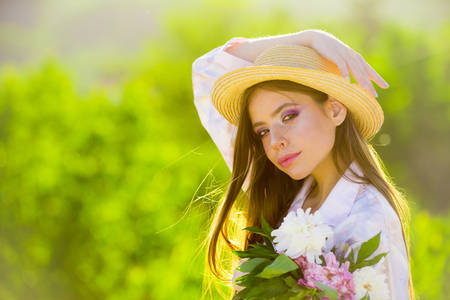 Good-looking gardener. Natural beauty and spa therapy. Spring woman. Springtime and vacation. Summer girl with long hair. Woman with fashion makeup. face and skincare. Travel in summer.