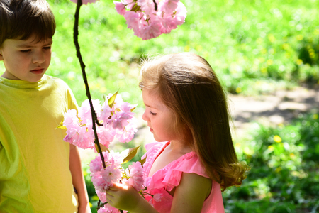 best friends, friendship and family. childhood first love. small girl and boy relations. summer couple of little children. face skincare. allergy to flowers. Springtime. Natural beauty. Childrens day.
