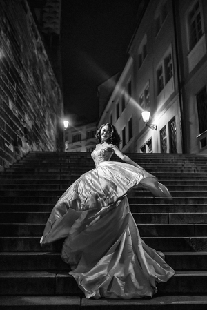 Pretty bride stands on steps
