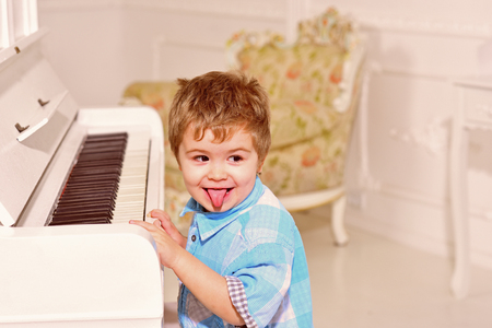 Music. child play piano. happy family and childrens day. happy childhood. Care development. Music and art education. Little boy playing piano. little boy train at school or home. Talanted children