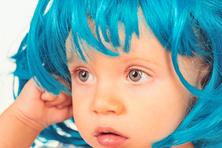 Cute and stylish. Small kid in fancy wig hairstyle. Small child wear blue wig hair. Adorable little child in fashion wig. Cute baby with long blue hair. Beauty look hairstyle for cosplay party Archivio Fotografico - 115012041