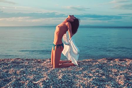 woman at sea sunrise. woman relax on beach sand. Stock fotó