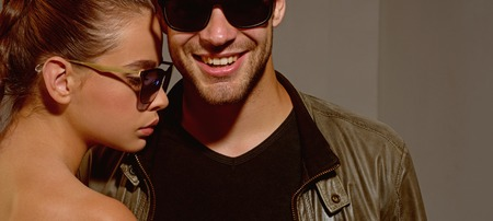 Friendly relations. Fashion models in trendy sun glasses. Couple in love. Couple of man and woman wear fashion glasses. Love relations. Friendship day. Friendship relations. Accessorize your eyesight Archivio Fotografico - 115012105