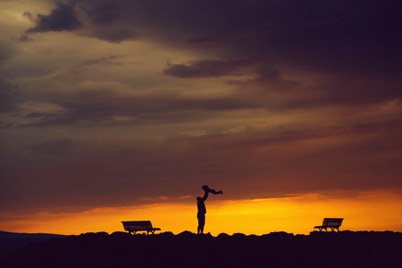 father and child on sunset