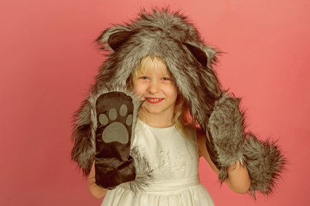 Little girl wear winter hat scarf and mitts. Little fashionista. Happy child smile in fashion style. Winter fashion trends for kids. So soft and warm. Stock Photo