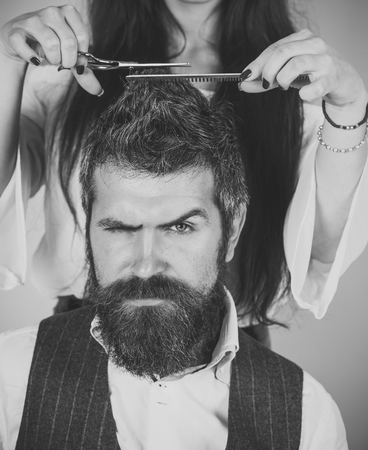 Couple make haircut, love relations. Couple in love at hairdresser. Imagens