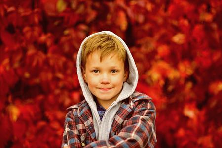 Autumn is time for back to school. Little schoolboy. Little child enjoy autumn season. Adorable child on autumn landscape. Hello autumn.