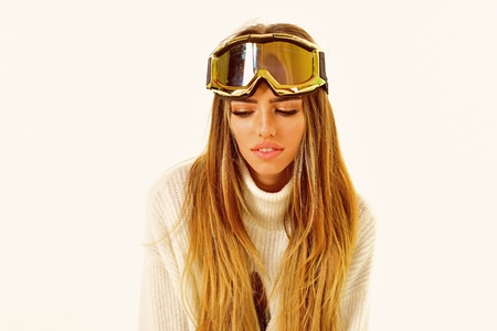 Good time. It is so cold. Happy winter holidays. Winter sport and activity. Girl in ski or snowboard wear. Sexy woman in winter clothes. Ski resort and snowboarding.