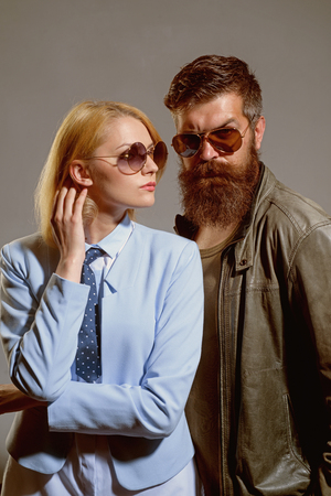 Glasses do more than improve your vision. Friendship day. Fashion models in trendy sun glasses. Couple in love. Couple of man and woman wear fashion glasses. Love relations. Friendship relations. Archivio Fotografico - 118683810