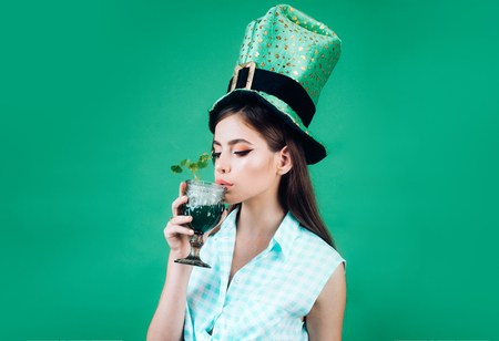 pretty girl in vintage style. retro woman drink summer cocktail. St. Patricks Day pin up woman with trendy makeup. pinup girl with fashion hair. Let the party begin Stock Photo