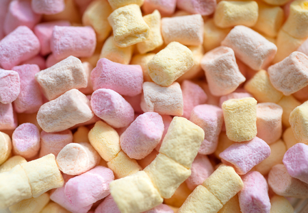 Spongy and sugary. Colorful mini marshmallow background or texture. Marshmallow souffle with sweet flavor. Marshmallow recipe with sugar and gelatin. Sweet snack food. Unhealthy junk food.