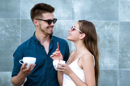 A coffee order says a lot about him. Couple in love drink coffee outdoor. Couple of woman and man with coffee cups. Girlfriend and boyfriend have espresso drink. Enjoying the best coffee date.