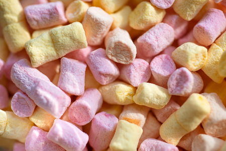 Soft and chewy. Sweet snack food. Colorful mini marshmallow background or texture. Marshmallow souffle with sweet flavor. Marshmallow recipe with sugar and gelatin. Unhealthy junk food.