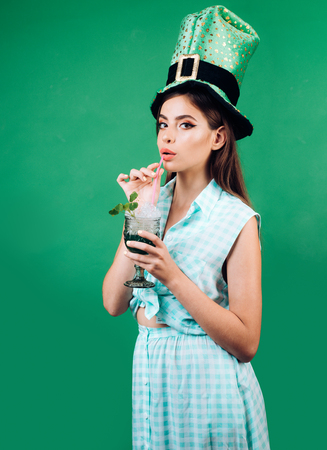 pin up woman with trendy makeup. pinup girl with fashion hair. retro woman drink summer cocktail. St. Patricks Day pretty girl in vintage style. girl in costume. Stock Photo